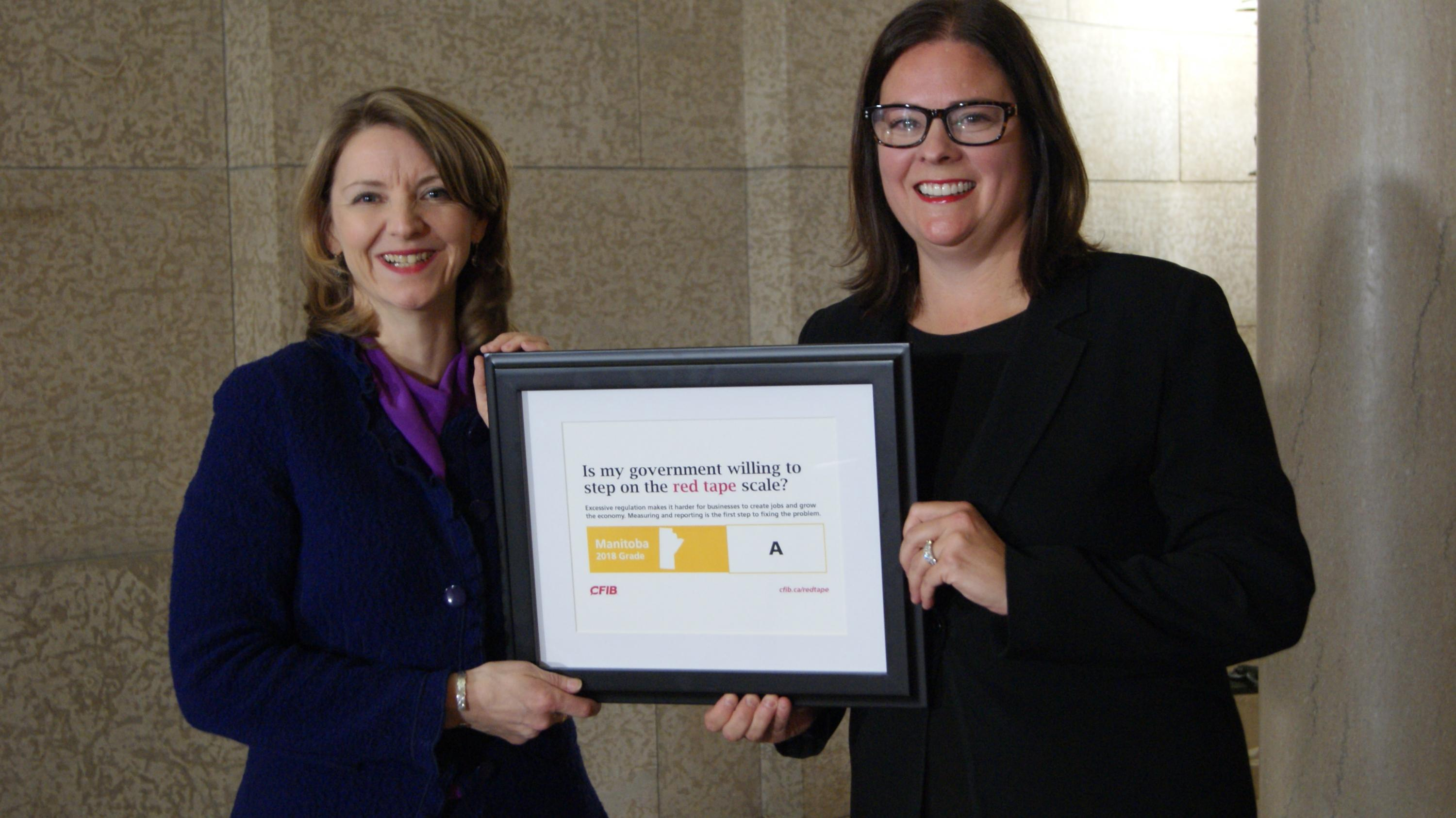 CFIB's Laura Jones presents Manitoba's 2018 Red Tape Report Card grade to Deputy Premier Heather Stefanson