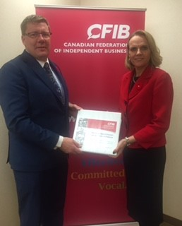 CFIB's Marilyn Braun-Pollon presents business priorities to Scott Moe during the leadership race.