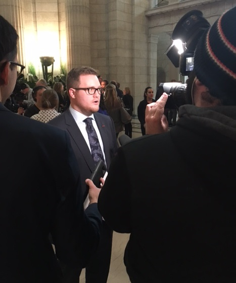 CFIB's Jonathan Alward scrums with media after Manitoba budget in Winnipeg on March 12, 2018