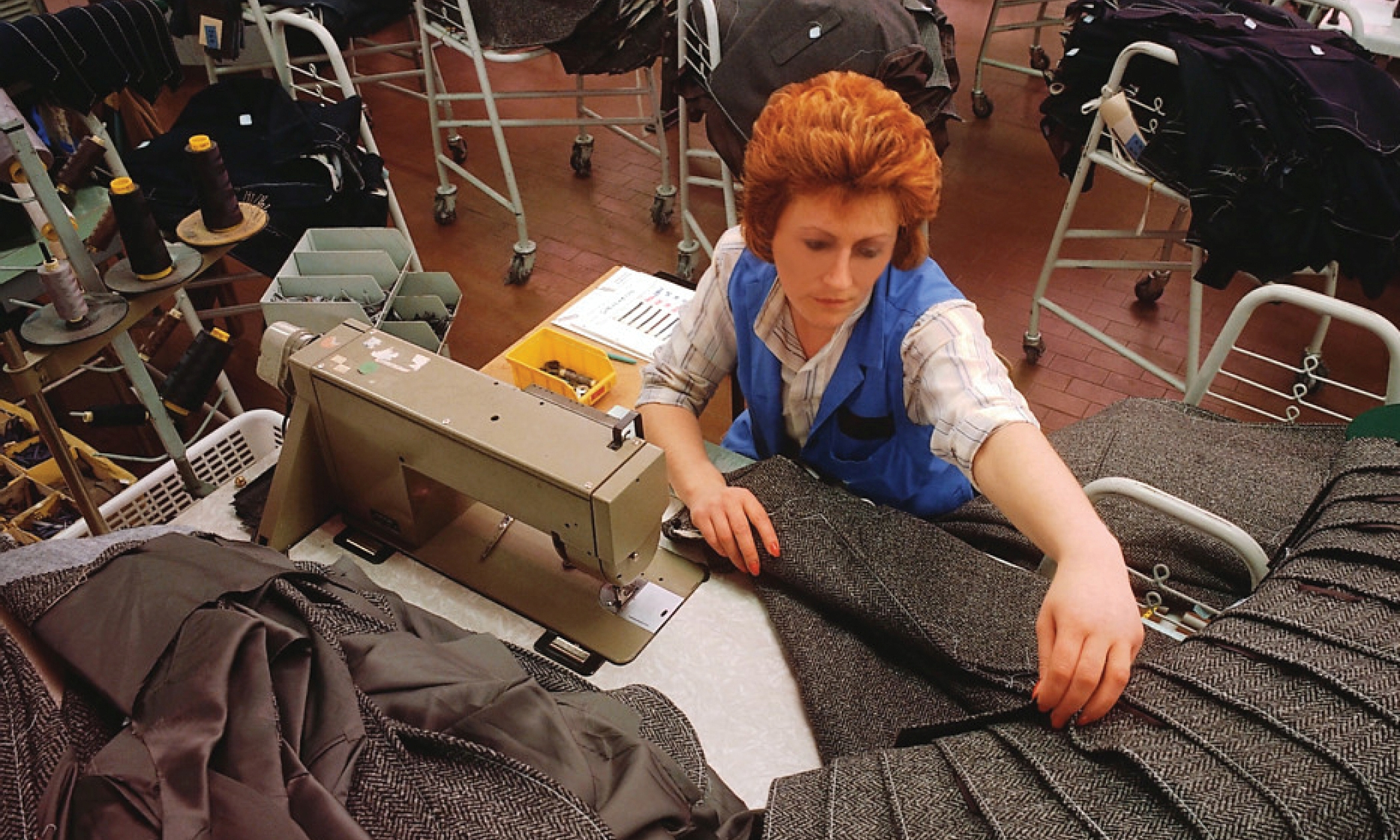 woman at a textile plant sewing